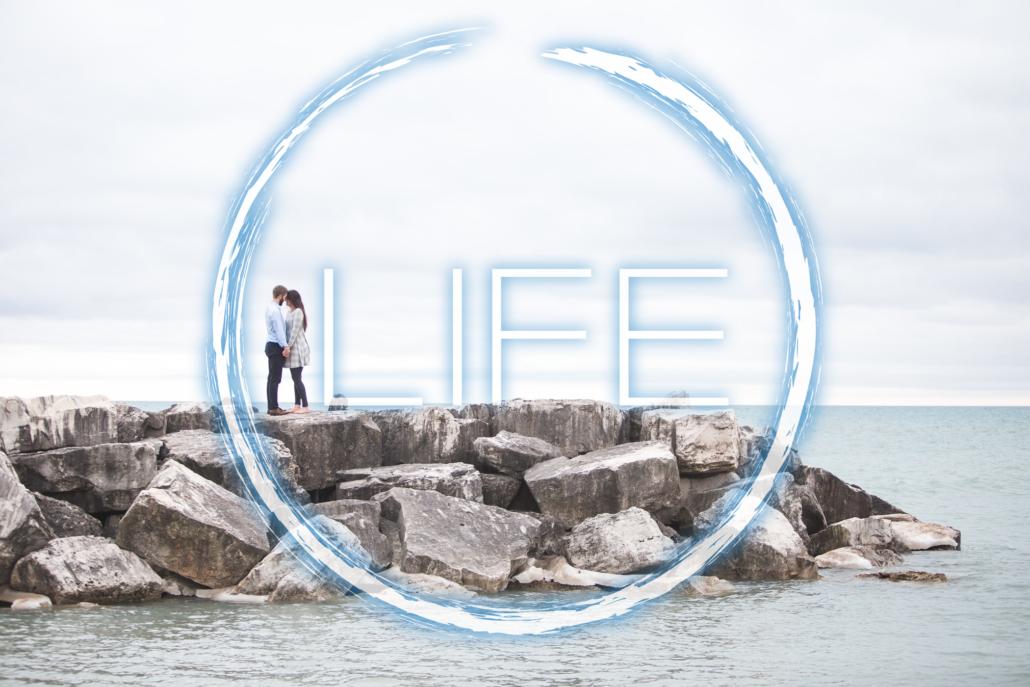 Life Logo; Couple on beach